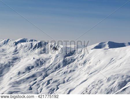 View On Off-piste Snowy Sunlight Slope At Sun Winter Evening. Caucasus Mountains, Georgia, Region Gu