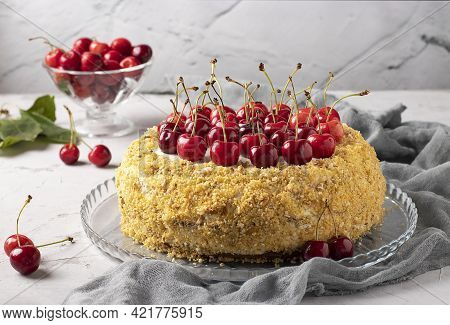 Homemade Festive Cake With Sweet Cherries On A Gray Background. Top Of The Cake Is Decorated With Fr