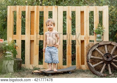 Sweet Happy Little Boy In The Park. Happy Child Looking At The Camera. Pretty Boy With Funny Express