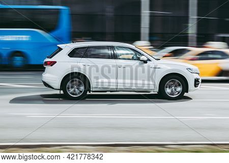 Moscow , Russia - April 2021: Side View Of Volkswagen Touareg, Which Is Driving On Streets Of City C