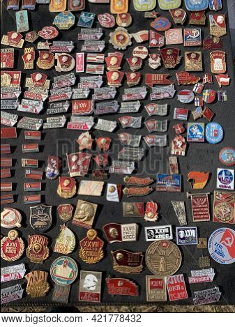 Collection Of Soviet Red Enamel Badges For Sale In Antique Market. Adazi, Latvia - May 8, 2021