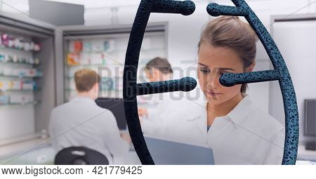 Double helix over a pharmacist with drugstore in the background, healthcare and medicine concepts. digitally generated image