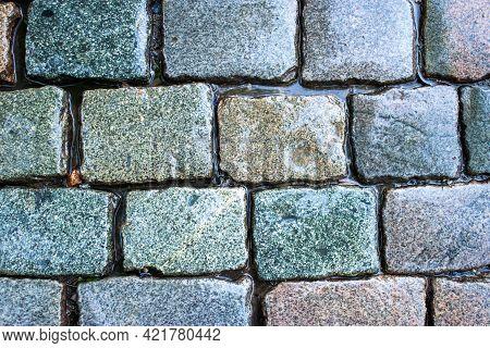 Cobblestone Pavement After The Rain. Close Up