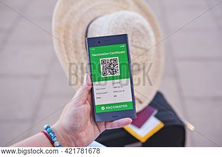 Smartphone In Hand Displaying On App Mobile Valid Digital Green Vaccination Certificate For Covid-19