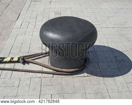 Steel Mooring Bollard With Knotted Ropes Anchoring Ships In Sea Or River Port