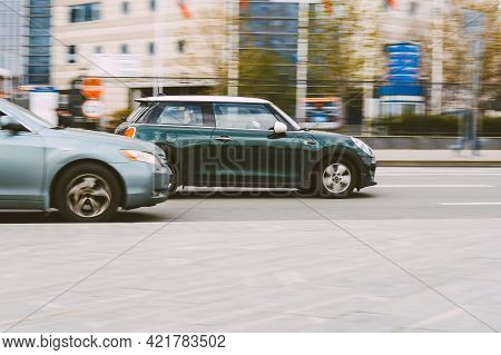 Moscow, Russia - May, 2021: Mini Cooper Is Accelerating In Highway On Urban Background