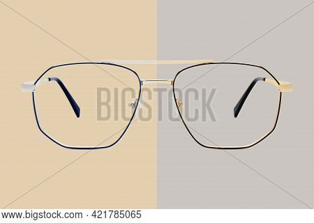 Silver And Golden Metal Color Eye Glasses Isolated On Beige And Gray Background, Ideal Photo Templat