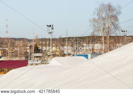 Ski Resort, Gentle Snow Slope With Artificial Lighting Towers And Trees. Mountain Slope For Skiing A