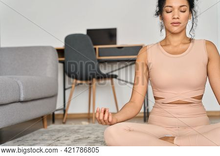 Cutout. Young Healthy African American Mixed Race Girl Sitting On Mat At Home In Lotus Pose, Eyes Cl