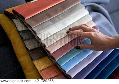 Choosing Upholstery Fabric Color And Texture From Various Colorful Samples In A Store. Female Custom