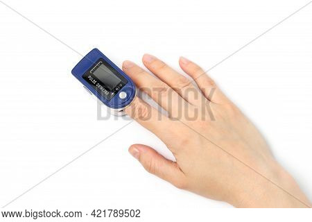 Hand With A Finger In Pulse Oximeter To Measure Oxygen In The Blood Isolated At The White Background