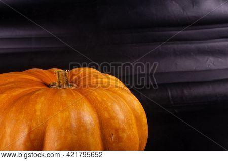 Whole Fresh Orange Big Pumpkin On Black Background, Closeup. Organic Agricultural Product, Ingredien