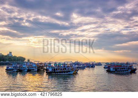 Tourist boats in sea on sunrise in Mumbai,Maharashtra, India