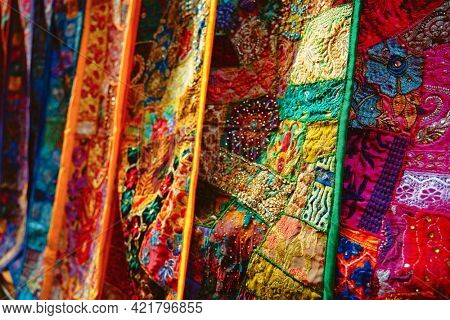 Indian patchwork fabric with traditional Indian patterns close up. Jasialmer, Radjasthan, India Exotic Patchwork Quilt