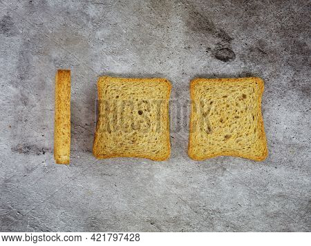 Minimal Conceptual Photo Of The Hundred Number Obtained With Three Rusks. High Quality Photo