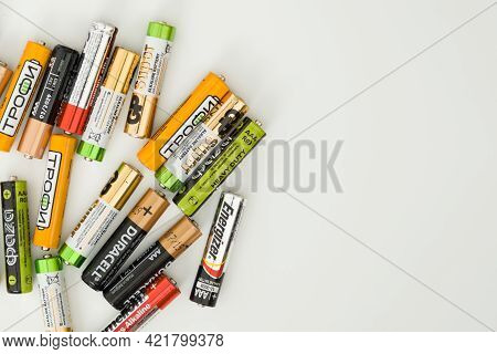 Ivanovo, Russia May 25, 2021, Lots Of Colorful Aa And Aaa Batteries On A White Background, Close-up.