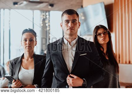Group of successful business people standing together at office.