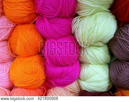 Balls Of Colored Multicolored Yarn. Close Up Of Yarn Balls. Knitting Shop Center. A Lot Of Color Yar