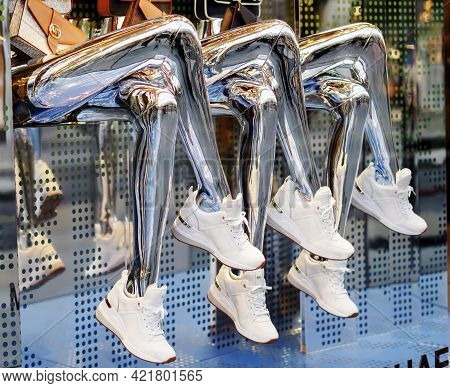 London, England, April,17,2021 - Silver Legs Mannequins In Shop Front Display