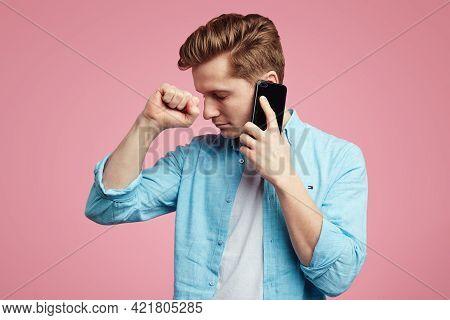 Dissatisfied Unhappy Man Has Unpleasant Phone Conversation