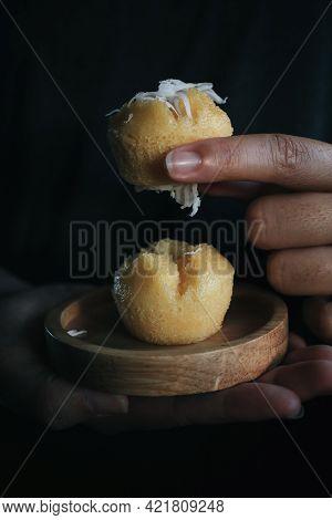 Hand Pick Up Toddy Palm Cake With Coconut (kanom Tarn) , Thai Dessert Sweet Taste Delicious. Dark To