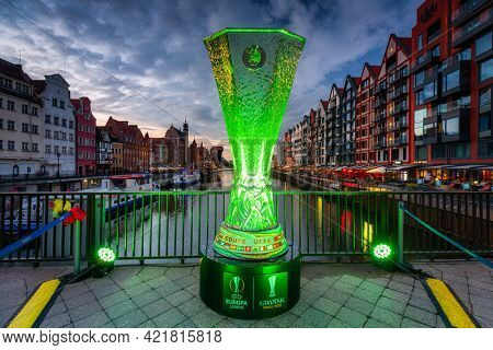 Gdansk, Poland - May 23, 2021: A huge copy of the Europa League Cup on the Green Bridge in Gdansk at dusk. The Europa League final will take place at the Gda?sk stadium on Wednesday, May 26, 2021.