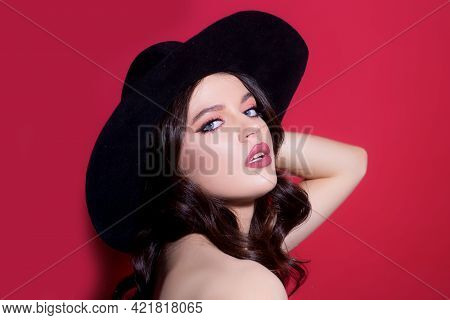 Trendy Retro Fashion. High-fashion Portrait. Sexy Sensual Elegant Woman In Black Hat. Isolated.
