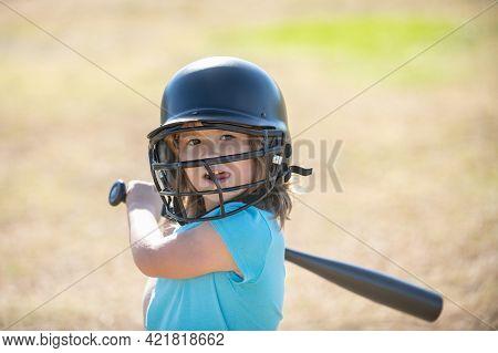 Little Child Baseball Player Focused Ready To Bat. Kid Holding A Baseball Bat.