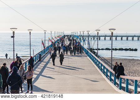 Sunset In Palanga, Lithuania View From Pier. Pedestrian Bridge At The Baltic Sea In Palanga.lithuani
