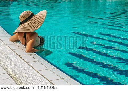 Summer Sale. Young Sexy Woman In Sun Hat, Bikini Swimsuit, Sunglasses Relaxing In Blue Pool Water. S
