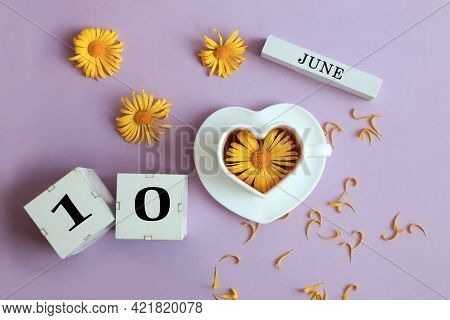 Calendar For June 10: The Name Of The Month Of June In English, Cubes With The Number 10, A Cup Of T