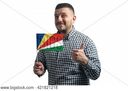 White Guy Holding A Flag Of Seychelles And Shows The Class By Hand Isolated On A White Background. L