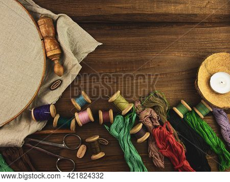 Embroidery Needlework Background With Linen In Hoop. Colorful Floss Thread, Scissors, Card Tag In Fe