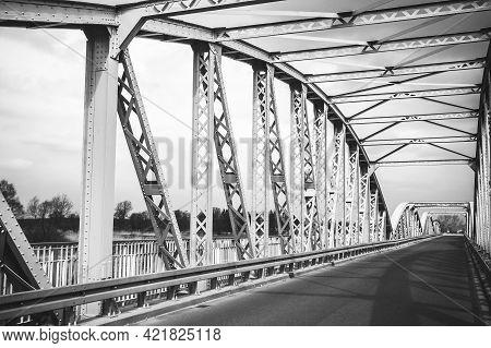 Metal Bridge Background. Road Bridge Construction. Empty Asphalt Road. Stormy Weather Long Bridge Ov