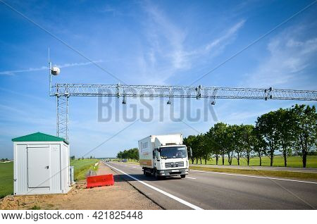 Belarus: 25.06.2013 - Road Toll. Gate With Barriers By Toll Road On A Highway.