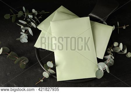 Scented Sachets And Eucalyptus Branches On Black Table