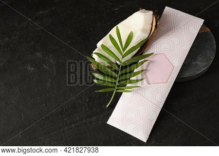 Scented Sachet, Green Leaf And Piece Of Coconut On Black Table, Above View. Space For Text
