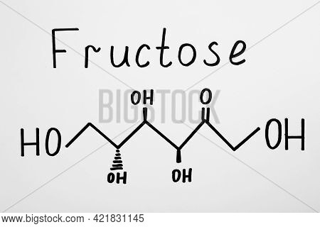 Word Fructose With Drawn Scheme On Paper, Top View