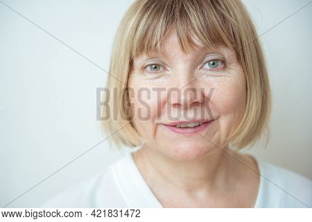 Close Up Portrait Beautiful Older Woman Against White Background. Senior Citizens Day. Caring For Th