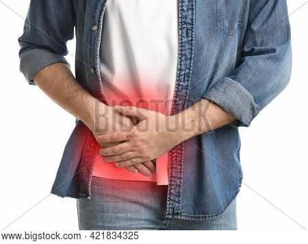 Man Suffering From Acute Appendicitis On White Background, Closeup
