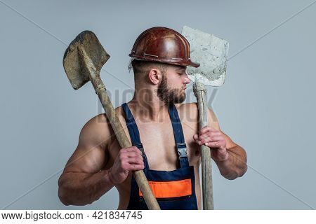 Build And Construction. Sexy Man With Shovel. Professional Constructor Or Mechanic. Builder Engineer