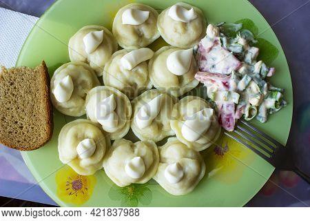 Traditional Russian Dumplings, Homemade Meat Dumplings In A White Plate On A Bamboo Napkin