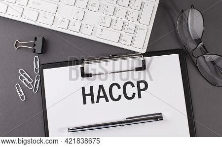 Office Paper Sheet With Text Haccp And Keyboard. Business