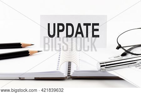 Text Update On Paper Card,pen, Pencils,glasses,financial Documentation On The Table - Business Conce