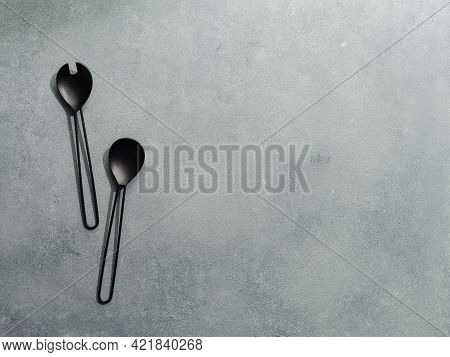 Salad Serving Utensils And Copy Space For Text Or Design. Salad Serving Utensils On Gray Stone Backg