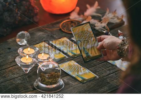 Woman holds tarot cards in her hands. Concept of psychic advisor or ways of divination