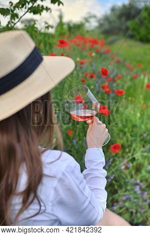 Young Woman With Rose  Wine In Glass On Poppy Field
