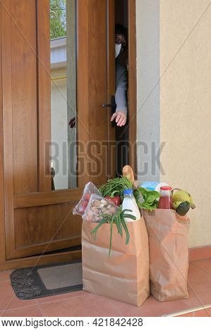 Delivering Food To A Self-isolate Woman Or Quarantine At Home