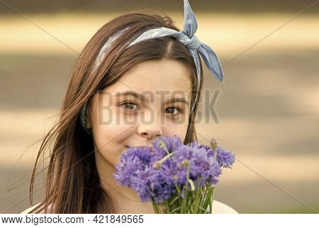 Chic Floral Look. Small Child Hold Blue Flowers Outdoors. Beauty Look Of Cute Girl. Fashion Look Of