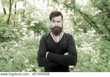 Being Fashionable Every Day. Fashion Guy. Fashion Model Keeping Arms Crossed On Natural Landscape. B